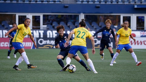 Brazil midfielder Camila, left, and forward Marta, right, watch as teammate Jucinara (22) moves the ball against Japan forward Yuka Momiki, center-left, in the second half of a Tournament of Nations women's soccer match, Thursday, July 27, 2017, in Seattle. The match ended in a 1-1 tie. (AP Photo/Ted S. Warren)