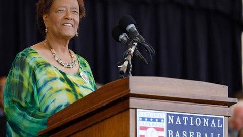 In this photo provided by the National Baseball Hall of Fame and Museum, former sportswriter Claire Smith speaks from the podium during her induction Saturday, July 29, 2017,to the National Baseball Hall of Fame in Cooperstown, N.Y. Smith is the first woman to win the J.G. Taylor Spink Award for meritorious contributions to baseball writing. (Milo Stewart Jr./National Baseball Hall of Fame and Museum via AP)