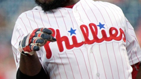 Philadelphia Phillies' Odubel Herrera is hit with a pitch from Atlanta Braves' Sean Newcomb during the second inning of a baseball game against the Atlanta Braves, Saturday, July 29, 2017, in Philadelphia. (AP Photo/Tom Mihalek)
