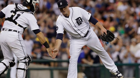 Detroit Tigers relief pitcher Justin Wilson greets catcher Alex Avila after the team's 5-3 win over the Houston Astros in a baseball game, Saturday, July 29, 2017, in Detroit. (AP Photo/Carlos Osorio)
