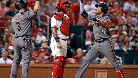 Arizona Diamondbacks' Ketel Marte (4) is congratulated by Daniel Descalso (3) as St. Louis Cardinals catcher Yadier Molina waits after Marte hit a two-run home run during the eighth inning of a baseball game Saturday, July 29, 2017, in St. Louis. (AP Photo/Jeff Roberson)