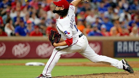 Texas Rangers relief pitcher Tony Barnette throws to the Baltimore Orioles in the seventh inning of a baseball game, Saturday, July 29, 2017, in Arlington, Texas. (AP Photo/Tony Gutierrez)