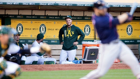 Oakland Athletics' Sonny Gray, center, watches from the dugout as his team takes on the Minnesota Twins during the fourth inning of a baseball game on Saturday, July 29, 2017, in Oakland, Calif. (AP Photo/D. Ross Cameron)