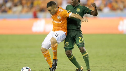 Houston Dynamo midfielder Alex (14) shields the ball from Portland Timbers midfielder Diego Chara (21) during the second half of an MLS soccer match Saturday, July 29, 2017, in Houston. (Thomas B. Shea/Houston Chronicle via AP)