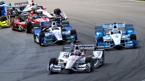 Will Power, of Australia, leads the field through the first corner after the green flag at the IndyCar Honda Indy 200 auto race Sunday, July 30, 2017, at Mid-Ohio Sports Car Course in Lexington, Ohio. (AP Photo/Tom E. Puskar)
