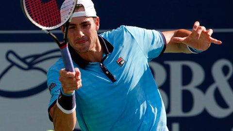 John Isner returns a shot to Ryan Harrison during the finals of the Atlanta Open tennis tournament Sunday, July 30, 2017, in Atlanta. (AP Photo/John Bazemore)