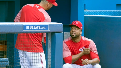 Toronto Blue Jays' Marco Estrada, left, talks with teammate Francisco Liriano, right, in the dugout during a baseball game against the Los Angeles Angels in Toronto, Sunday, July 30, 2017. (Fred Thornhill/The Canadian Press via AP)