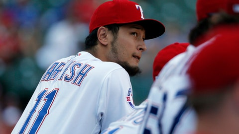 Texas Rangers' Yu Darvish, of Japan, watches play against the Baltimore Orioles in the ninth inning of a baseball game, Sunday, July 30, 2017, in Arlington, Texas. (AP Photo/Tony Gutierrez)
