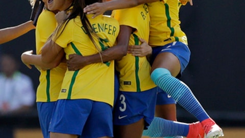 Brazil's team celebrates after midfielder Debinha scored against the United States during the first half of a Tournament of Nations women's soccer match Sunday, July 30, 2017, in San Diego. (AP Photo/Gregory Bull)