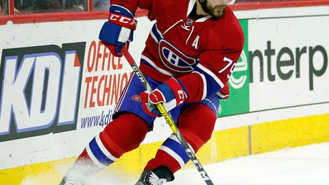 FILE - In this Feb. 2, 2017, file photo, Montreal Canadiens' Andrei Markov moves the puck during an NHL hockey game in Philadelphia. Longtime Montreal Canadiens defenseman Markov has signed with the Russian Kontinental Hockey League club Ak Bars Kazan, it was reported on Monday, July 31, 2017. (AP Photo/Tom Mihalek, File)