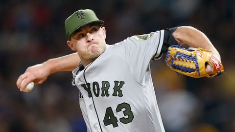 FILE - In this May 27, 2017, file photo, New York Mets relief pitcher Addison Reed pitches against the Pittsburgh Pirates in a baseball game, in Pittsburgh. The Mets have agreed to trade reliever Addison Reed to the Boston Red Sox, Monday, July 31, 2017, for three 22-year-old right-handed pitching prospects, a deal contingent on the teams approving medical records of the players involved. (AP Photo/Keith Srakocic, File)