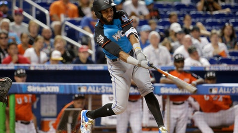 FILE - In this July 9, 2017, file photo, World Team's Amed Rosario, of the New York Mets, bats during the first inning of the All-Star Futures baseball game against the U.S. Team in Miami. The Mets are bringing up top shortstop prospect Rosario and say the 21-year-old will be in the starting lineup Tuesday, Aug. 1, 2017, at Colorado in his major league debut. (AP Photo/Lynne Sladky, File)