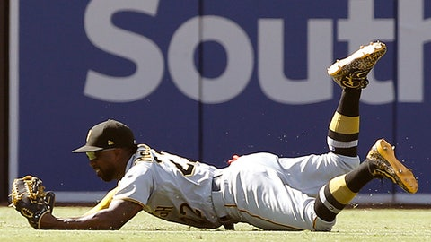 FILE - In this July 30, 2017, file photo, Pittsburgh Pirates center fielder Andrew McCutchen cradles the ball in his glove after making a diving catch of San Diego Padres' Yangervis Solarte's fly ball during the eighth inning of a baseball game in San Diego. The Pirates sent former closer Tony Watson to the Los Angeles Dodgers at the trade deadline and acquired veteran reliever Joaquin Benoit from Philadelphia. The Pirates also held on to centerfielder McCutchen and pitcher Gerrit Cole. (AP Photo/Alex Gallardo, File)