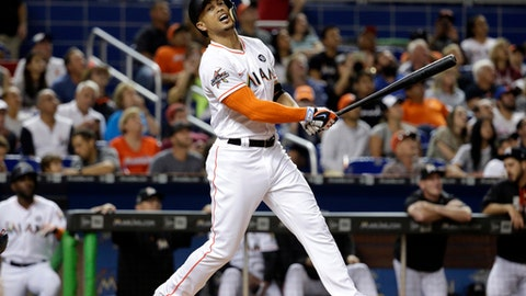 Miami Marlins' Giancarlo Stanton reacts after he flew out to the shortstop during the fourth inning of a baseball game against the Washington Nationals, Monday, July 31, 2017, in Miami. (AP Photo/Lynne Sladky)