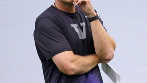 Washington head coach Chris Petersen looks on at the team's first official NCAA college football practice of the year Monday, July 31, 2017, in Seattle. (AP Photo/Elaine Thompson)