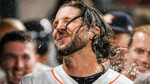 Houston Astros' Jake Marisnick is doused with water after hitting a solo home run off Tampa Bay Rays relief pitcher Chase Whitley during the fifth inning of a baseball game, Monday, July 31, 2017, in Houston. (AP Photo/Eric Christian Smith)
