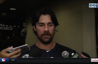Images of Cole Hamels holds Marlins to four runs in win