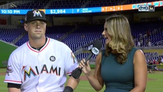Tyler Moore faces the inevitable pie from the clubhouse monkey after the win over the Reds