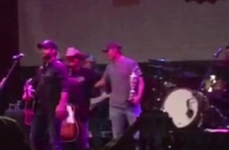 Images of Jordan Spieth parties with Claret Jug at Dallas concert