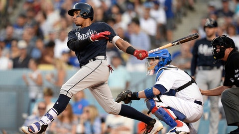 July 22, 2017; Los Angeles, CA, USA; Atlanta Braves third baseman Johan Camargo (17) hits a double in the fifth inning against the Los Angeles Dodgers at Dodger Stadium. Mandatory Credit: Gary A. Vasquez-USA TODAY Sports