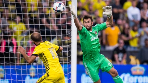 Jul 1, 2017; Columbus, OH, USA; Atlanta United goalkeeper Alec Kann (25) tries to keep a crossing ball away from Columbus Crew SC forward Federico Higuain (10) at MAPFRE Stadium. Mandatory Credit: Greg Bartram-USA TODAY Sports