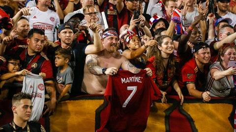 Jul 4, 2017; Atlanta, GA, USA; Atlanta United fans celebrate a victory against the San Jose Earthquakes at Bobby Dodd Stadium at Historic Grant Field.   Mandatory Credit: Brett Davis-USA TODAY Sports