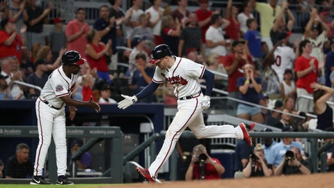 Jul 14, 2017; Atlanta, GA, USA; Atlanta Braves third baseman Freddie Freeman (5) celebrates his solo home run with third base coach Ron Washington (37) in the sixth inning against the Arizona Diamondbacks at SunTrust Park. Mandatory Credit: Jason Getz-USA TODAY Sports