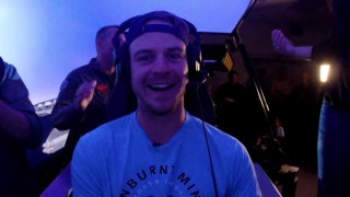 Wil Myers takes a ride in an F-18 simulator