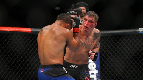 Jul 22, 2017; Long Island, NY, USA; Dennis Bermundez (red gloves) fights Darren Elkins (blue gloves) during UFC Fight Night at Nassau Coliseum. Mandatory Credit: Brad Penner-USA TODAY Sports