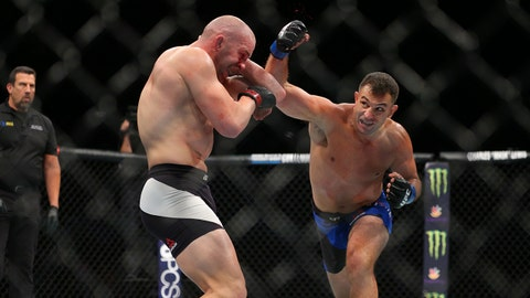 Jul 22, 2017; Long Island, NY, USA; Patrick Cummins (red gloves) fights Gian Villante (blue gloves) during UFC Fight Night at Nassau Coliseum. Mandatory Credit: Brad Penner-USA TODAY Sports