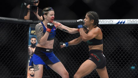 Jul 16, 2017; Glasgow, Scotland, United Kingdom; (EDITORS NOTE: Graphic Content) Joanne Calderwood (red gloves) fights Cynthia Calvillo (blue gloves) during UFC Fight Night at SSE Hydro. Mandatory Credit: Per Haljestam-USA TODAY Sports