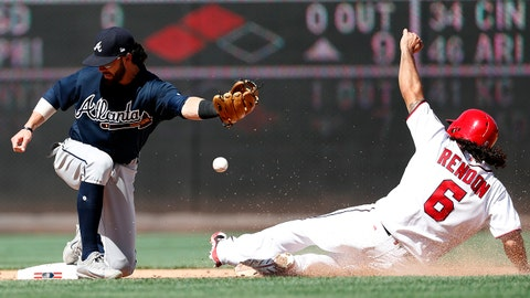 Washington Nationals' Anthony Rendon (6) safely steals second base as Atlanta Braves shortstop Dansby Swanson can't handle the throw during the seventh inning of a baseball game at Nationals Park, Sunday, July 9, 2017, in Washington. Rendon advanced to third base on the play. The Nationals won 10-5. (AP Photo/Alex Brandon)