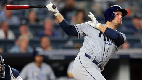 Jul 28, 2017; Bronx, NY, USA; Tampa Bay Rays first baseman Lucas Duda (21) follows through on a solo home run against the New York Yankees during the seventh inning at Yankee Stadium. Mandatory Credit: Brad Penner-USA TODAY Sports