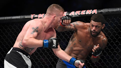 July 7, 2017; Las Vegas, NV, USA; Michael Johnson (red gloves) fights Justin Gaethje (blue gloves) during The Ultimate Fighter Finale at T-Mobile Arena. Mandatory Credit: Kyle Terada-USA TODAY Sports