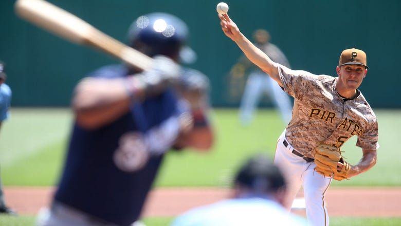 Brewers bats held in check as Pirates complete sweep