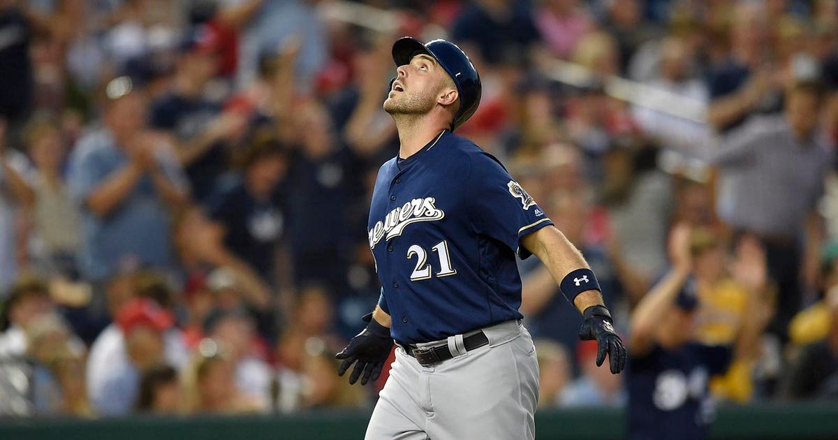 Brewers hit trio of homers to back Davies' strong start