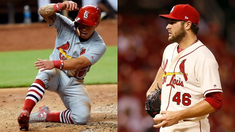 Cardinals second baseman Kolten Wong and pitcher Kevin Siegrist