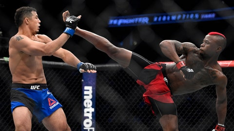 July 7, 2017; Las Vegas, NV, USA; Marc Diakiese (red gloves) fights Drakkar Klose (blue gloves) during The Ultimate Fighter Finale at T-Mobile Arena. Mandatory Credit: Kyle Terada-USA TODAY Sports