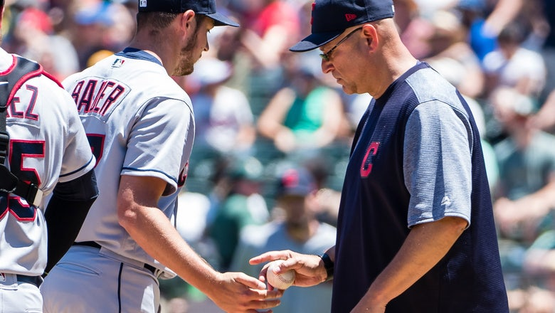 Bauer gets just 2 outs; A's top Indians 7-3 for 3-game sweep