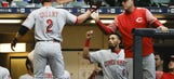 Reds build early lead, hang on for 11-10 win over Brewers