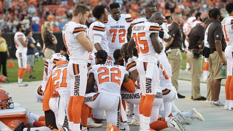 Aug 21, 2017; Cleveland, OH, USA; Members of the Cleveland Browns kneel during the national anthem before a game against the New York Giants at FirstEnergy Stadium. Mandatory Credit: Ken Blaze-USA TODAY Sports