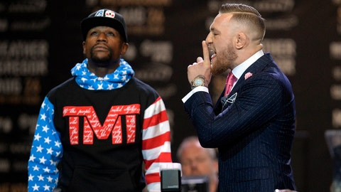 July 11, 2017; Los Angeles, CA, USA; Conor McGregor gestures toward Floyd Mayweather during a world tour press conference to promote the upcoming Mayweather vs McGregor boxing fight at Staples Center. Mandatory Credit: Gary A. Vasquez-USA TODAY Sports