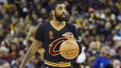 Dec 29, 2016; Cleveland, OH, USA; Cleveland Cavaliers guard Kyrie Irving (2) brings the ball up court against the Boston Celtics during the first quarter at Quicken Loans Arena. Mandatory Credit: Ken Blaze-USA TODAY Sports