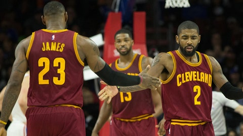 Nov 27, 2016; Philadelphia, PA, USA; Cleveland Cavaliers forward LeBron James (23) reacts with guard Kyrie Irving (2) after a tip in basket against the Philadelphia 76ers during the second quarter at Wells Fargo Center. Mandatory Credit: Bill Streicher-USA TODAY Sports