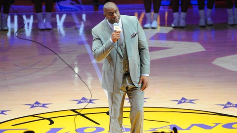"Apr 13, 2016; Los Angeles, CA, USA; Los Angeles Lakers former player Earvin ""Magic"" Johnson introduces Lakers forward Kobe Bryant (not pictured) before a game against the Utah Jazz at Staples Center. Bryant concludes his 20-year NBA career tonight. Mandatory Credit: Gary A. Vasquez-USA TODAY Sports"