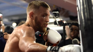 Conor McGregor vs. Floyd Mayweather fight approved for 8-ounce gloves