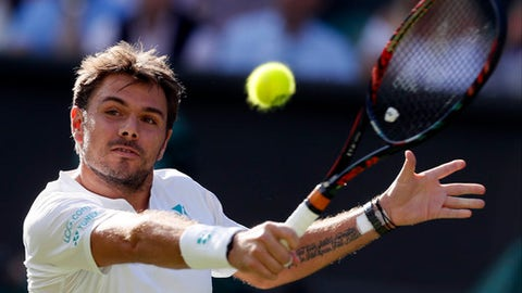 Switzerland's Stan Wawrinka returns to Russia's Daniil Medvedev during their Men's Singles Match on the opening day at the Wimbledon Tennis Championships in London Monday, July 3, 2017. (AP Photo/Kirsty Wigglesworth)