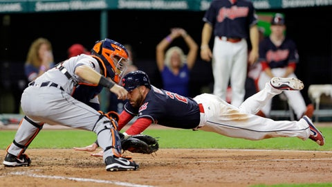 Cleveland Indians' Jason Kipnis dives into home plate to score as Detroit Tigers catcher Alex Avila waits for the ball during the seventh inning of a baseball game, Friday, July 7, 2017, in Cleveland. (AP Photo/Tony Dejak)