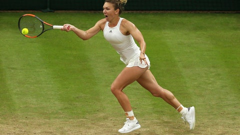 Romania's Simona Halep returns the ball against Britain's Johanna Konta during their Women's Quarterfinal Singles Match on day eight at the Wimbledon Tennis Championships in London Tuesday, July 11, 2017. (AP Photo/Tim Ireland)
