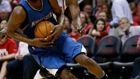 HOUSTON, TX - APRIL 12:  Andrew Wiggins #22 of the Minnesota Timberwolves drives around James Harden #13 of the Houston Rockets at Toyota Center on April 12, 2017 in Houston, Texas. NOTE TO USER: User expressly acknowledges and agrees that, by downloading and/or using this photograph, user is consenting to the terms and conditions of the Getty Images License Agreement.  (Photo by Bob Levey/Getty Images)